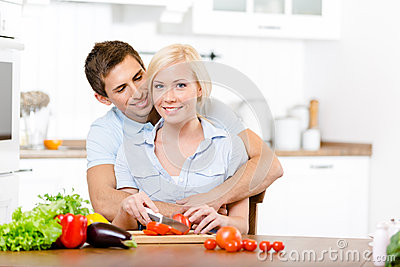 Young couple preparing breakfast together