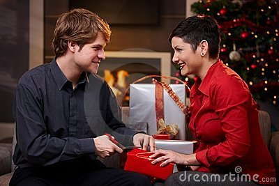 Young couple preparing for christmas eve