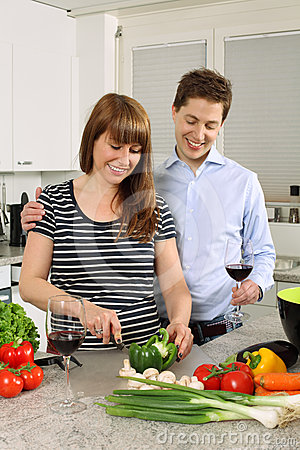 Young couple preparing salad