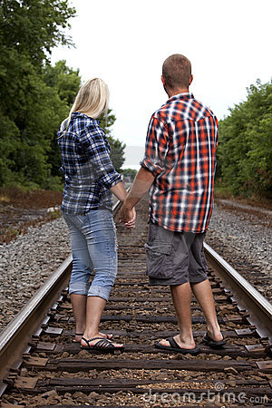 Young Couple on railroad tracks