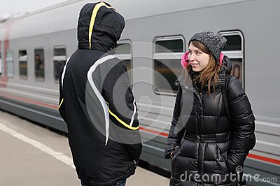 Young couple on railway station platform