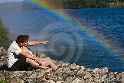 Young Couple with a rainbow