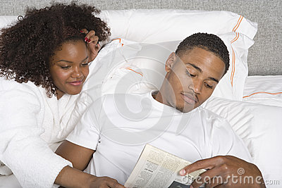 Young Couple Reading Newspaper Together