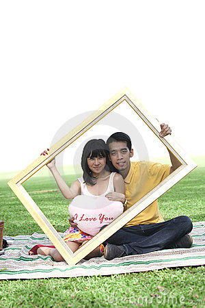 Young couple with rectangle frame