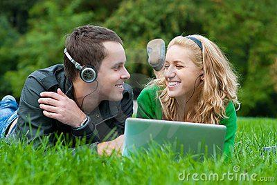 Young couple relax and listen to music