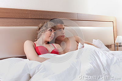 Young couple relaxing in bedroom