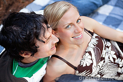 Young couple relaxing on picnic blanket