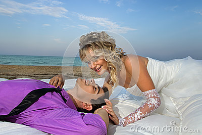 Young couple resting in bed