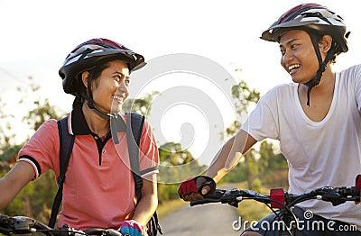 Young couple riding bike