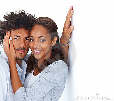 Young couple romancing together over white