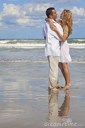 Young Couple In Romantic Embrace On A Beach