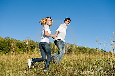 Young couple running