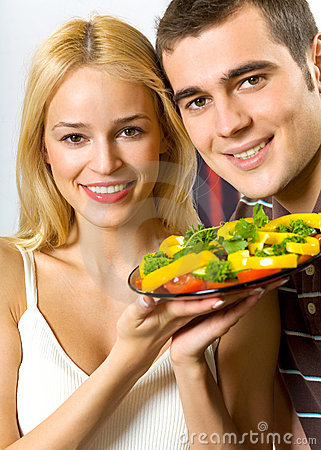 Young couple with salad