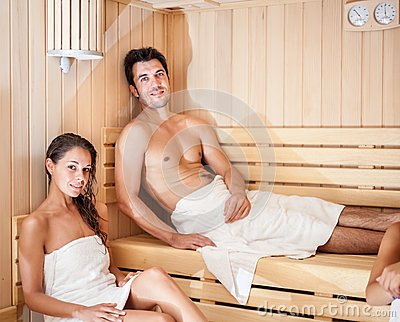 Young couple in a sauna
