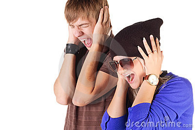 Young couple screaming.