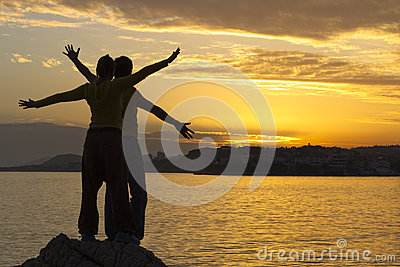 Young couple at sea sunset