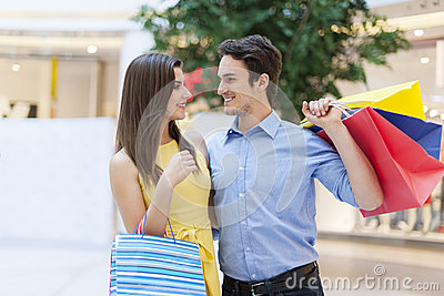 Young couple after shopping