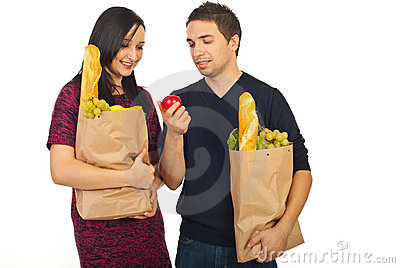 Young couple at shopping looking at apple