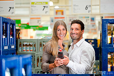 Young couple shopping together at supermarket