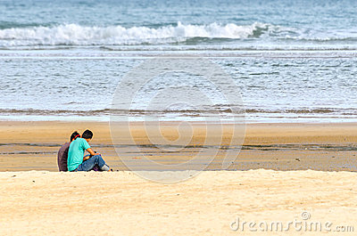 Young couple sitting and having fun