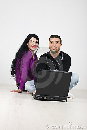 Free Young Couple Sitting On Floor With Laptop Royalty Free Stock Images - 14018299