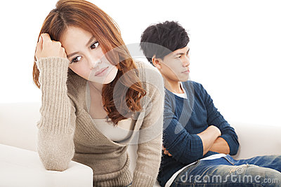 Young Couple sitting on the sofa during conflict Stock Photo