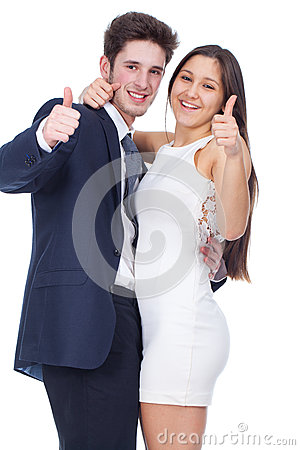 Young couple smiling with thumbs up gesture