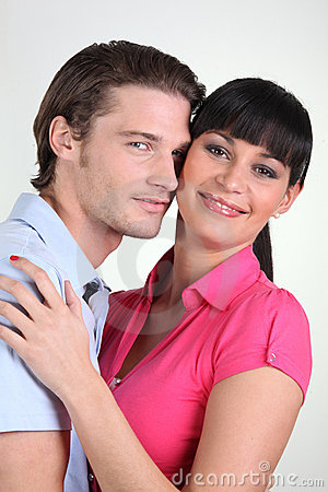 Young couple smiling on white background