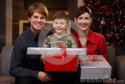 Young couple and son at christmas