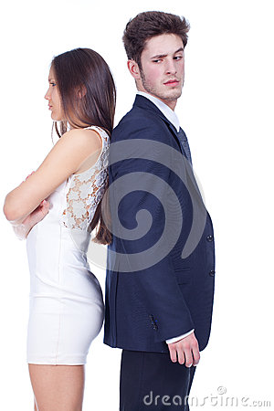 Young couple standing back-to-back