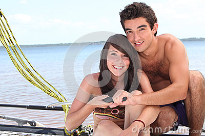Young couple steering a catamaran