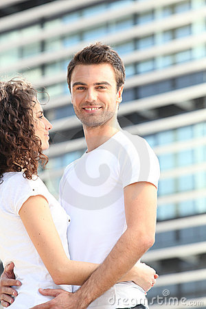 Young couple stood outside