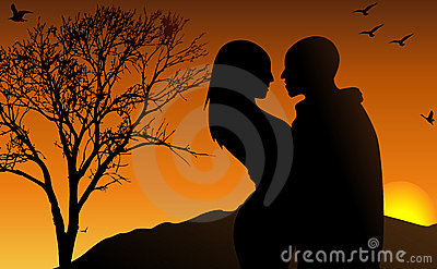 Young couple in the sun set
