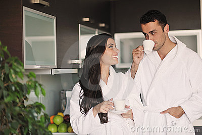 Young couple taking fresh morning cup of coffee