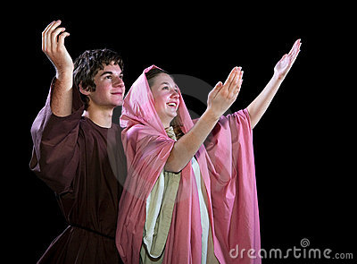 Young Couple With Their Arms Lifted in Praise