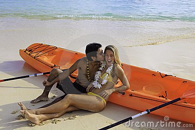 Young couple with their kayak