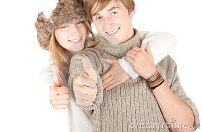 Young couple, thumbs up