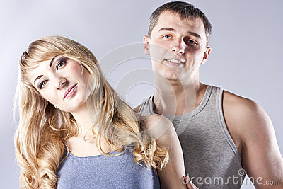 Young couple together on grey background