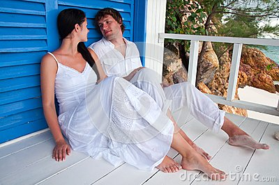 Young couple in tropical beach house