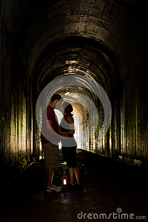 Young couple in a tunnel