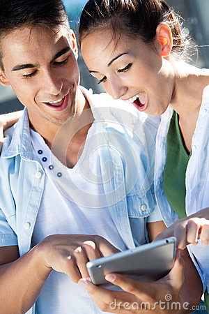 Young couple using a digital tablet
