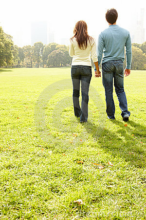 Young couple walking together in a field