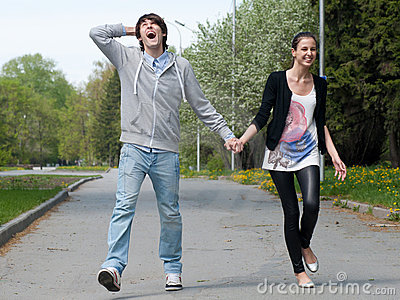 Young couple walking together in park