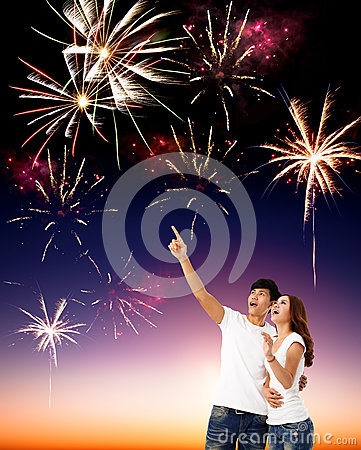 Young couple watching the fireworks