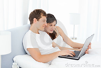 Young couple watching videos on their computer