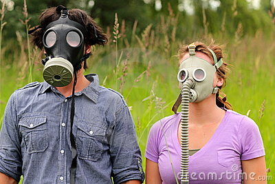 Young Couple Wearing Gas Masks