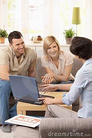 Free Young Couple With Estate Agent. Stock Images - 17724864