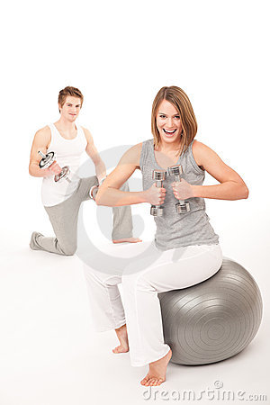 Free Young Couple With Weights And Fitness Ball Royalty Free Stock Photography - 12953427