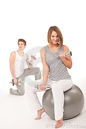 Free Young Couple With Weights,fitness Ballon White Royalty Free Stock Photos - 13018228