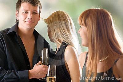 Young couple and woman holding glasses with champagne